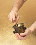 Close up of man hands with old mortar and pestle Stock Photography