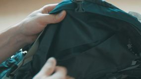 Close up of man hands packing things into travel bag. Close up of man hands packing things into travel bag stock footage