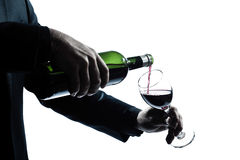 Close up man hands pouring red wine in a glass Stock Image