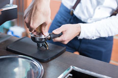 Close-up of man hands pressing coffee in holder Royalty Free Stock Photos
