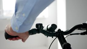 Close Up Man Hands Testing a Bicycle Inside a Sport Store stock footage