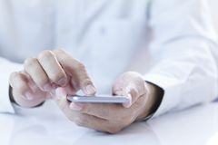 Man using mobile application on smartphone Royalty Free Stock Image