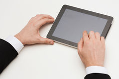 Close up of man hands touching tablet pc Royalty Free Stock Images