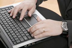 Close up of man hands typing o. N notebook Stock Photography