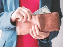 Close up man hands with wallet and Dollar money stock image