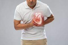 Close up of man having heart attack or heartache royalty free stock photo