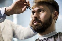 Close up of a man having his hair cut Royalty Free Stock Images