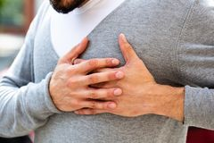 Man Suffering From Chest Pain stock photography