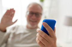 Close up of man having video call on smartphone Royalty Free Stock Image
