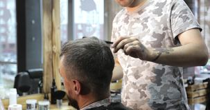 Close up of the man head at the barbershop. Stylist is working with model. Hairdressing. 4K footage stock footage