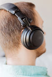 Close up of man in headphones at home Stock Photos