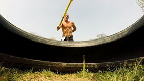 Close up of a man hitting tire with a hammer, changing hands stock footage