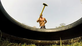Close up of a man hitting tire with a hammer, changing hands stock video footage