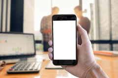 Close up man hold smartphone with blank screen mobile and busine Royalty Free Stock Photography