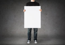 Close up of man holding big blank white board Royalty Free Stock Photos