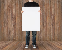 Close up of man holding big blank white board Royalty Free Stock Image