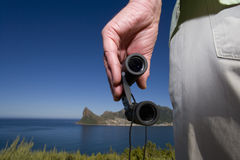 Close up of man holding binoculars Royalty Free Stock Images