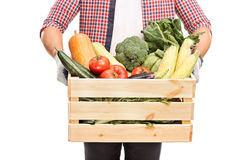 Close-up on man holding a crate full of vegetables Stock Image