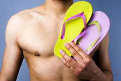Close-up of man holding flip-flops Royalty Free Stock Photos