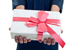 Close up man holding a gift box. Man holding a gift box in a gesture of giving Royalty Free Stock Image