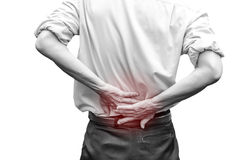 Close up of a  man holding his back in pain Royalty Free Stock Photo