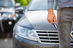 Close-up of man holding keys to new car. Copy space. Stock Images