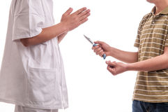 Close up of man, holding a knife in his hands, threatening a doctor Royalty Free Stock Photo