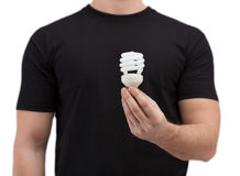 Close up of man holding light bulb Stock Photo