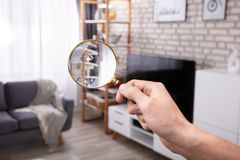 Close-up Of A Man Holding Magnifying Glass. Close-up Of A Man`s Hand Searching With Magnifying Glass At Home stock photos