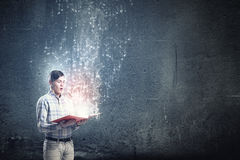 Close up of man holding opened book Stock Photography