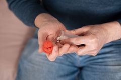 Close up of man holding pill case Stock Images
