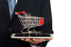 Close up man holding shopping cart on tablet Stock Photo