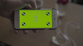Close Up Man Holding Smartphone With Green Screen stock video footage