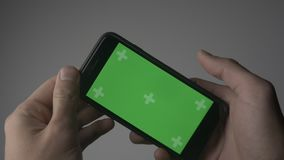 Close Up Man Holding Smartphone Touch With Green Screen Chroma Key. Close Up Man Holding Smartphone Touch With Green Screen stock video footage