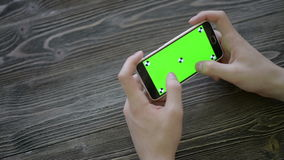 Close Up Man Holding Smartphone Touch Screen With Green Screen Chroma Key For stock video footage