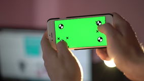 Close Up Man Holding Smartphone Touch Screen With Green Screen Chroma Key stock video footage