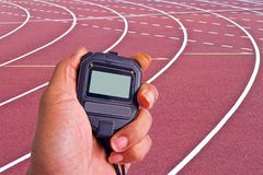Close-up of  man holding  stopwatch to measure performances Royalty Free Stock Images