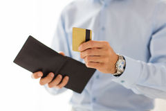 Close up of man holding wallet and credit card Royalty Free Stock Images