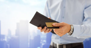 Close up of man holding wallet and credit card Stock Photography