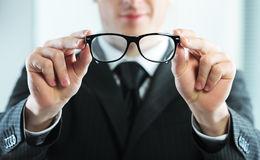 Close up of a man holds glasses Stock Images