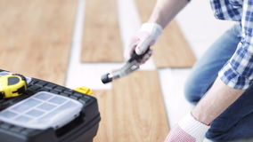 Close up of man installing wood flooring stock video footage