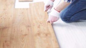 Close up of man installing wood flooring stock video