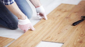 Close up of man installing wood flooring stock footage
