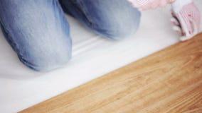 Close up of man installing wood flooring stock footage