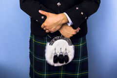 Close-up of man in kilt. Wearing a Campbell tartan and dress sporran Royalty Free Stock Photos