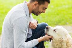 Close up of man with labrador dog outdoors Royalty Free Stock Photos