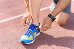 Close-up of man lacing sneakers Stock Photography