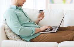 Close up of man with laptop and credit card Royalty Free Stock Photography