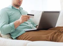 Close up of man with laptop and credit card Stock Photos