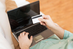 Close up of man with laptop and credit card Royalty Free Stock Images